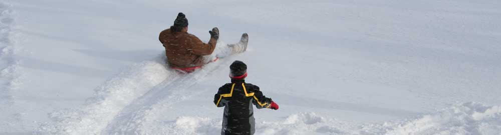 Sledding at Library Hill
